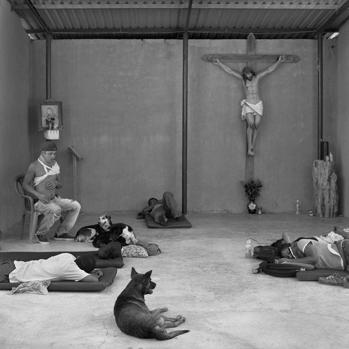 Weary and injured migrants rest in the makeshift chapel of the Hermanos en El Camino migrant shelter in the town of Ixtepéc, Oaxaca (2009).