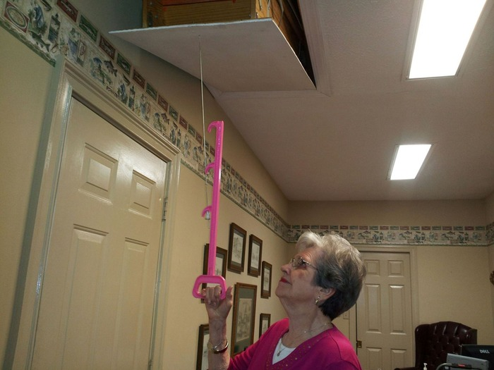 Getting Nanny to test out the Handy Reach.  Testing required 19 lbs of downward force to pull open the stairs.  She was not able to pull down the string without the Handy Reach!!