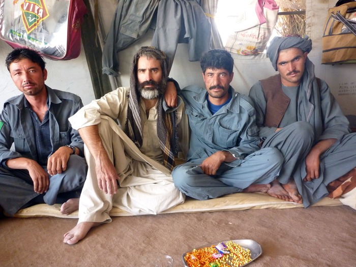 Louie with Afghan Police after covering fighting in the Arghandab Valley, Kandahar.