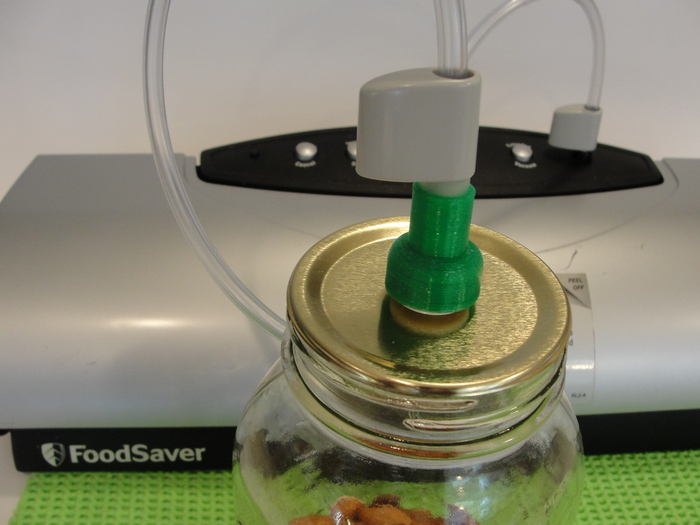 ThriftyVac Vacuum Hose Adapter Mating with the ThriftyVac Mason Jar Lid