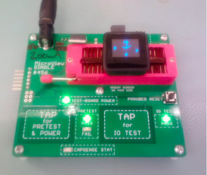 Microview in testing jig. This is where we burn the bootloader.