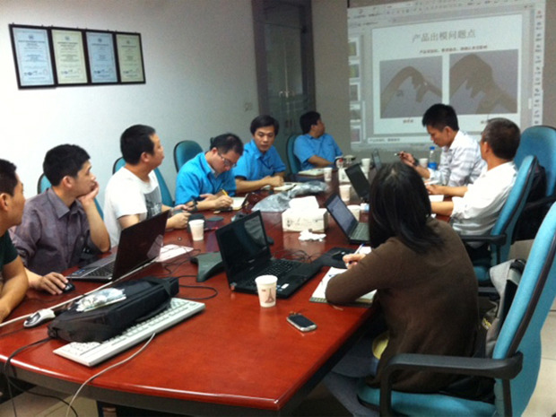 Kathy Yang, product supervisor from EastBridge Engineering at the table with the team from Tranwo reviewing design factors.