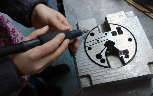 Polishing and surface finishing the mold.