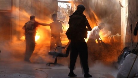 Tracey Shelton/GlobalPost. Tank fire hits a Syrian rebel post in Aleppo in late 2012, killing Issa Aiash, 30, his young brother Ahmed, 17, and Sheihk Mamoud, 42.