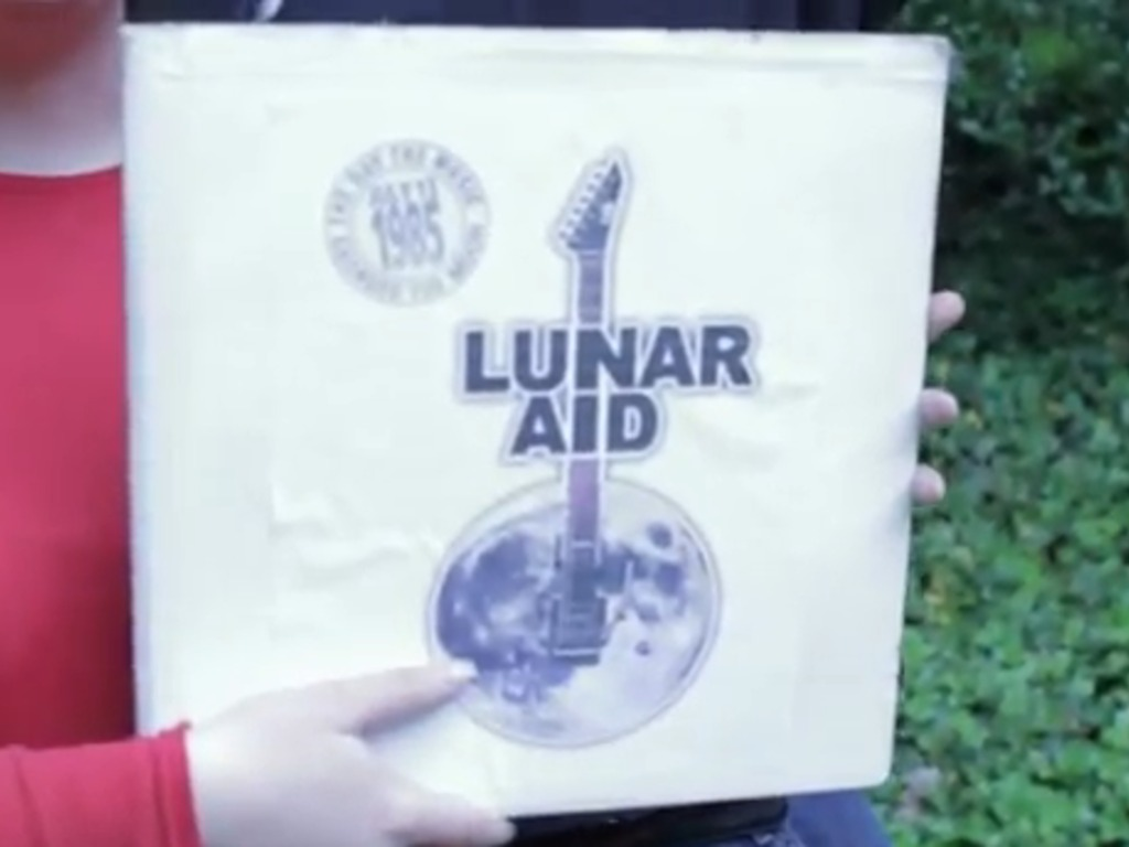 Space Folk Album: Lunar Aid 1985's video poster