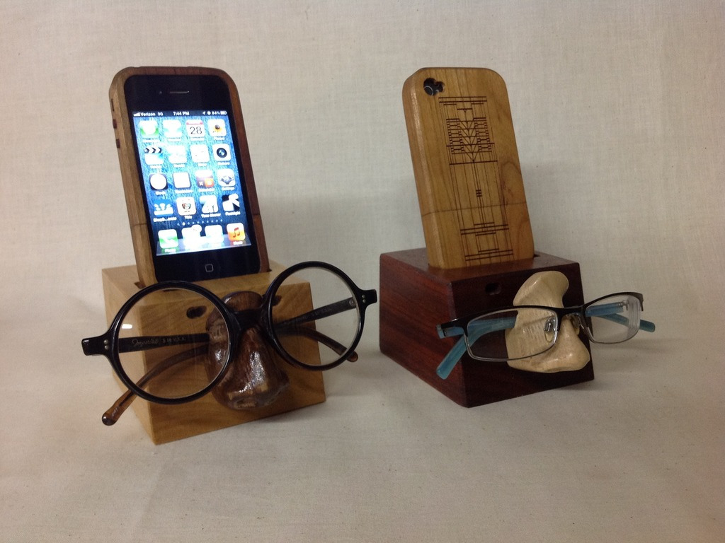 Wooden iPhone case, cradle, & nose for the 4/4S and 5's video poster
